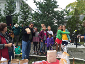 Chris Watson and young BSCC members announce the raffle winners at Harvest Fest 2015